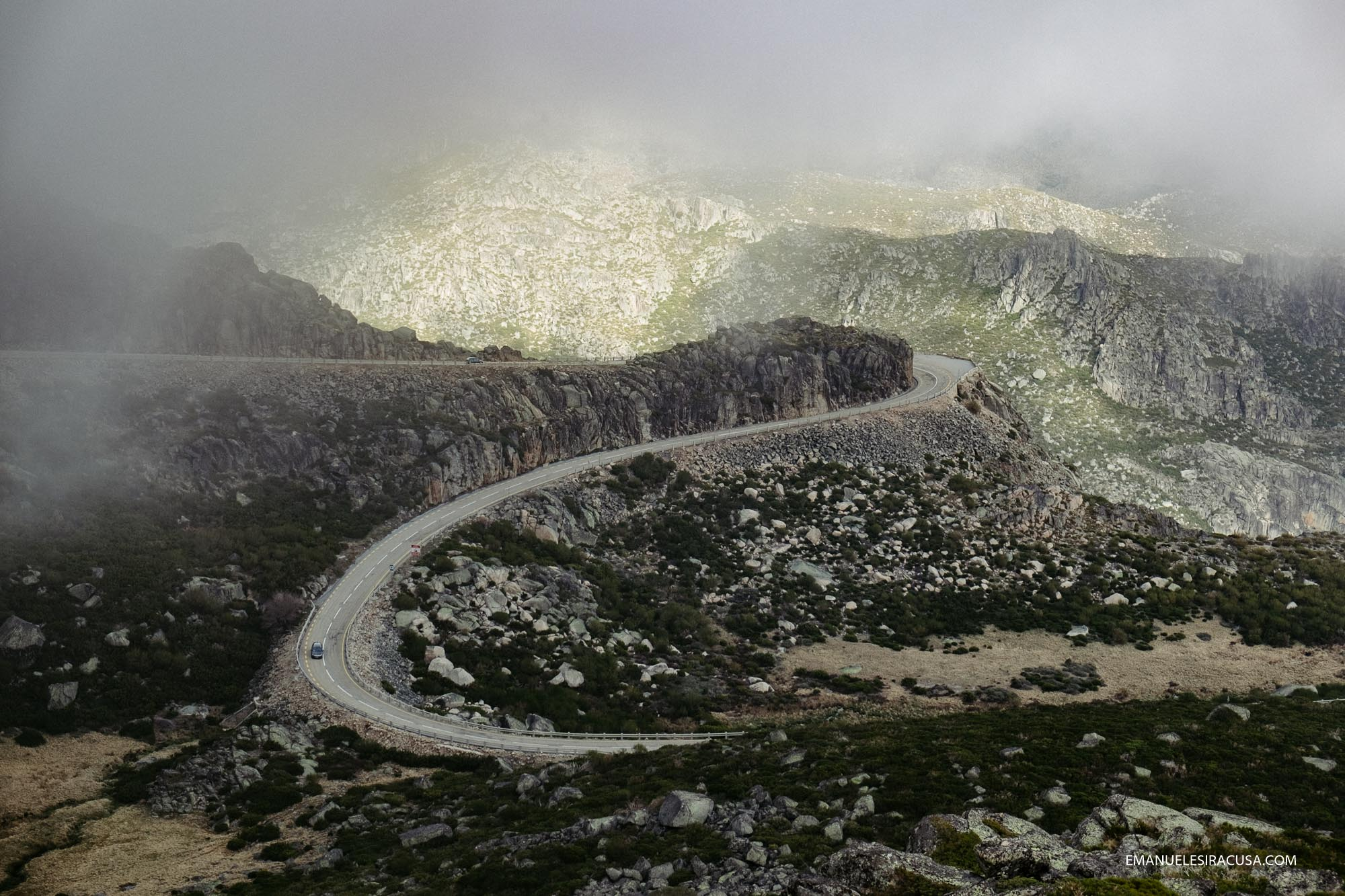 A Mountain road on the way up to Torre, the top of Serra da Estrela, in beautiful atmospheric light.